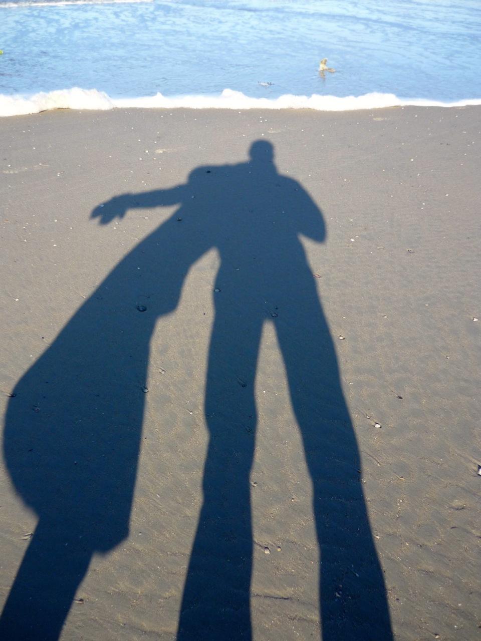 unsere Schatten im Sand